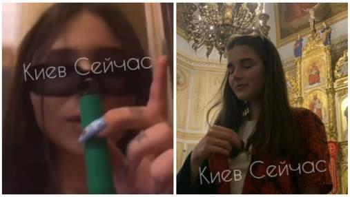 У церкві в Києві дівчата задували свічки, курили вейп і розпивали алкоголь – відео